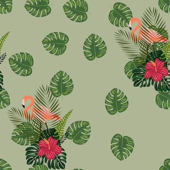 熱帯の花と葉のシームレスパターンを持つフラミンゴ。
