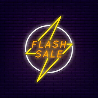 Flash sale colorful neon banner at brick wall. lightning in circle
