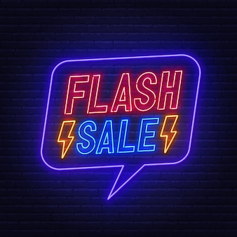 Flash sale neon sign on brick wall.