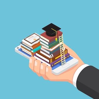 本と卒業帽付きのスマートフォンを持っているフラット3dアイソメトリックビジネスマンの手。オンライン教育とeラーニングのコンセプト。