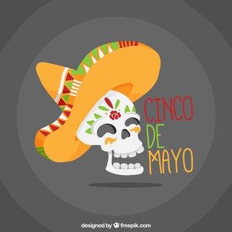 Sfondo piatto del cranio sorridente con il fieno messicano