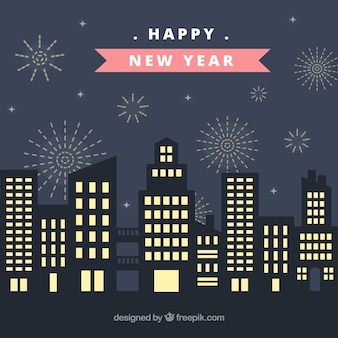 Flat background with a city on new year's night