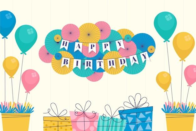 風船とフラットな誕生日の背景
