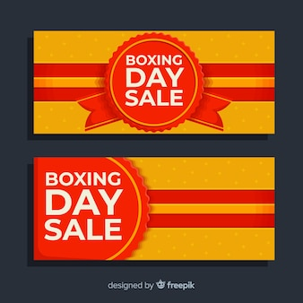 Flat boxing day sale banners with label and ribbons