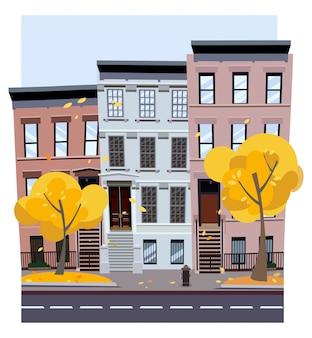 秋の街のフラット漫画スタイルのイラスト。 3〜4階建てのでこぼこの家。葉は木から飛ぶ。通りの街並み。手前の秋の木々と都市景観