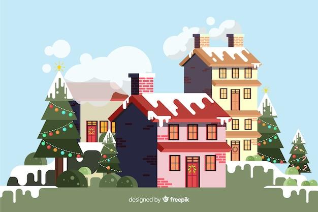 Плоский новогодний фон со зданиями в снегу