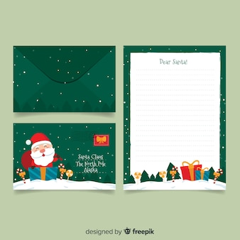 Flat christmas stationery template on green background
