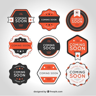 Flat collection of coming soon stamps with orange details Free Vector