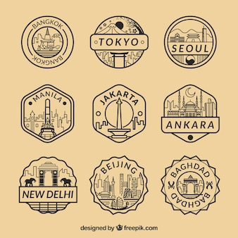 Flat collection of fantastic stamps with different cities Free Vector