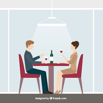 Coppie piatte bere vino in un ristorante