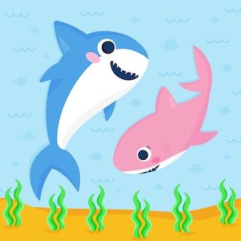 フラットなデザインの赤ちゃんサメの青とピンク