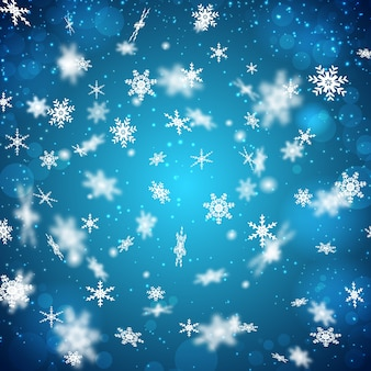 さまざまな形の白い雪片が落ちるフラットなデザインの青い背景
