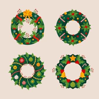 フラットなデザインのクリスマスの花と花輪のコレクション