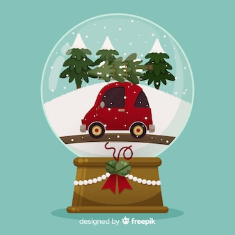 Flat design christmas snowball globe with car
