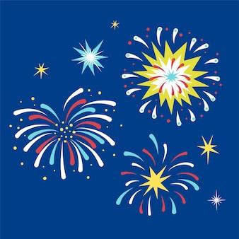 お祝いのための青い背景の上のフラットなデザインの花火要素