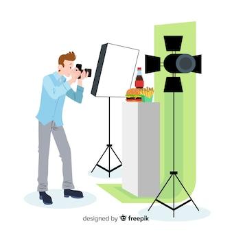 スタジオで写真を撮るフラットなデザイン写真家