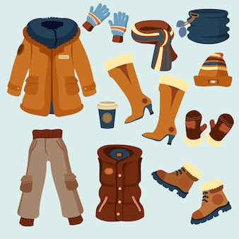 Vestiti invernali ed elementi essenziali di design piatto