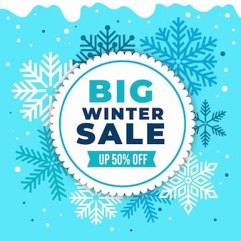 Зимняя распродажа в плоском дизайне со снежинками