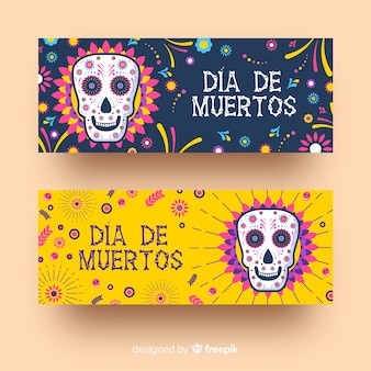 Flat día de muertos banners with isolated skulls