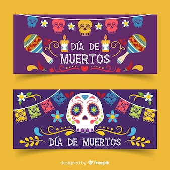 Flat día de muertos banners with maracas and skulls