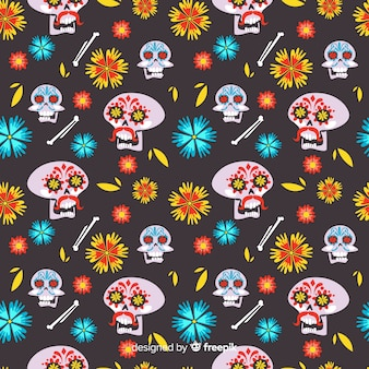 Flat día de muertos pattern with floral skulls