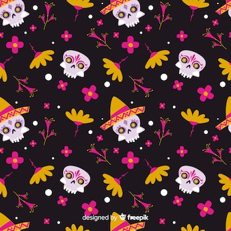 Flat día de muertos pattern with skulls and flowers