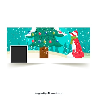 クリスマスツリーの下にキツネとフラットなフェイスブックカバー