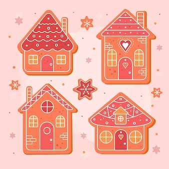 Flat gingerbread house collection on pink surface