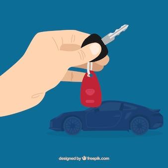 Fondo piano di chiave dell'automobile della tenuta della mano Vettore gratuito