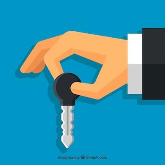 Плоский рука, держащая ключевой фон автомобиля