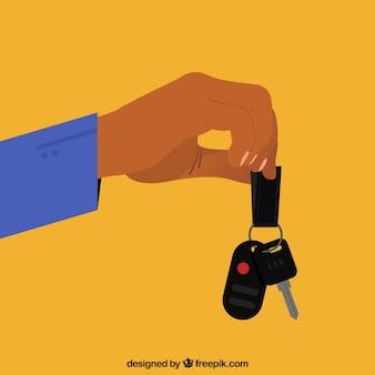 フラットな手が車のキーの背景を保持
