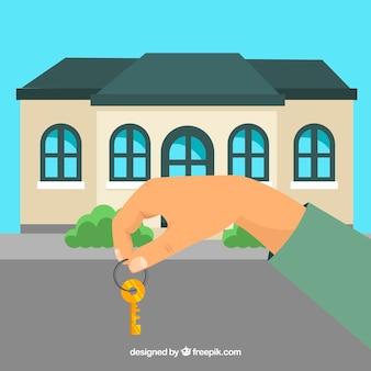 Fondo piano di chiave della casa della tenuta della mano
