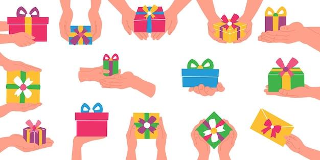 손에 선물 상자 축 하의 평면 그림.
