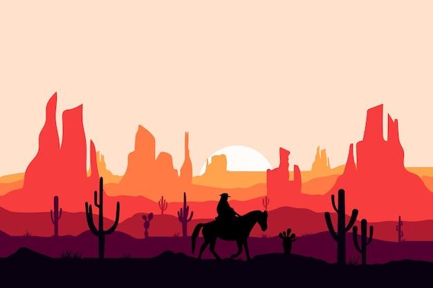 大きな岩の砂漠の平らな風景のカウボーイ