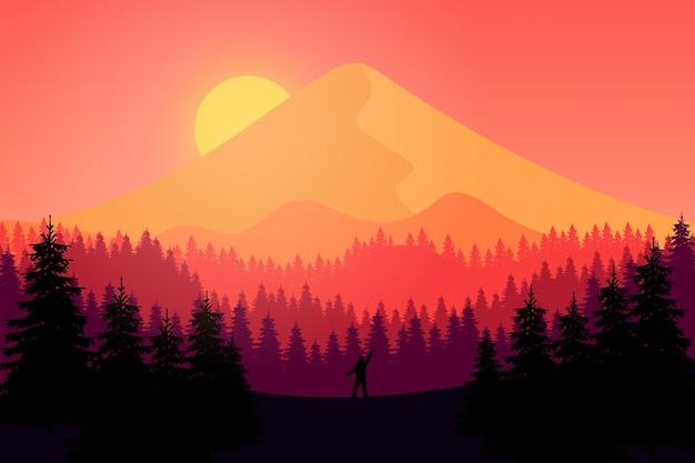 オレンジ色の夕日と午後の平らな風景の山々