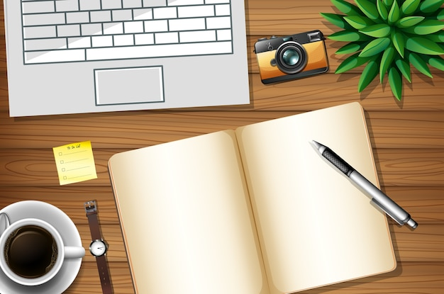 Flat lay of office work desk with office elements with green leaves