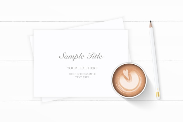 Flat lay top view elegant white christmas composition paper pencil and coffee on wooden background.
