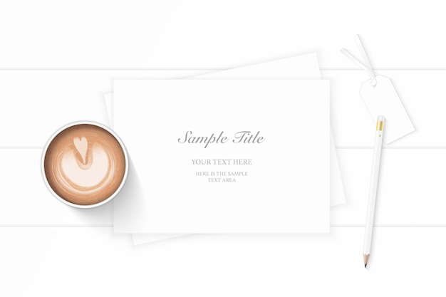 Flat lay top view elegant white christmas composition paper pencil tag coffee on wooden background.
