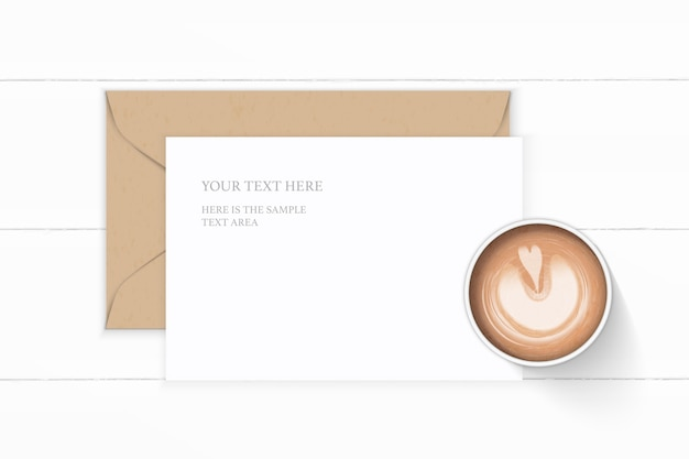 Flat lay top view elegant white composition letter kraft paper envelope coffee on wooden background.
