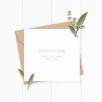 Flat lay top view elegant white composition letter kraft paper envelope nature leaf flower plant on wooden background.