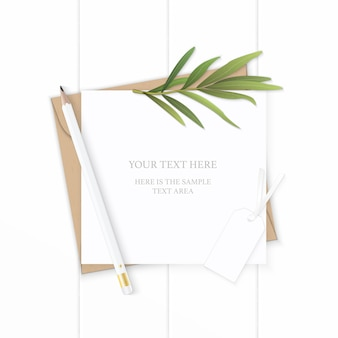 Flat lay top view elegant white composition letter kraft paper envelope nature tarragon leaf pencil and tag on wooden background.