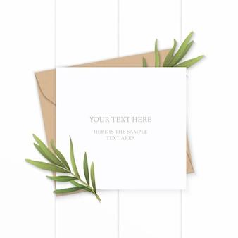 Flat lay top view elegant white composition letter kraft paper envelope nature tarragon leaf plant on wooden background.