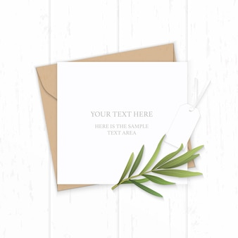 Flat lay top view elegant white composition letter kraft paper envelope nature tarragon leaf and tag on wooden background.