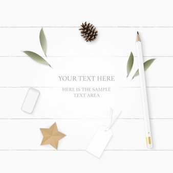 Flat lay top view elegant white composition paper leaf pine cone pencil eraser tag and star craft on wooden background.