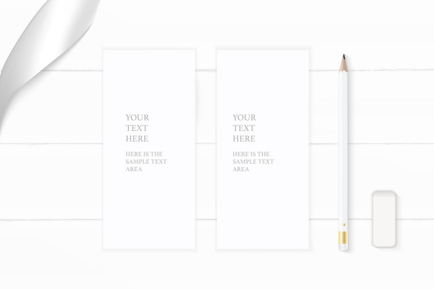 Flat lay top view elegant white composition paper pencil eraser and silver ribbon on wooden background.