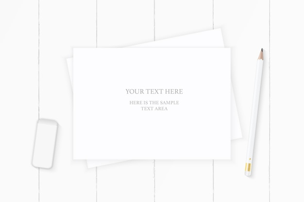 Flat lay top view elegant white composition paper pencil and eraser on wooden background.