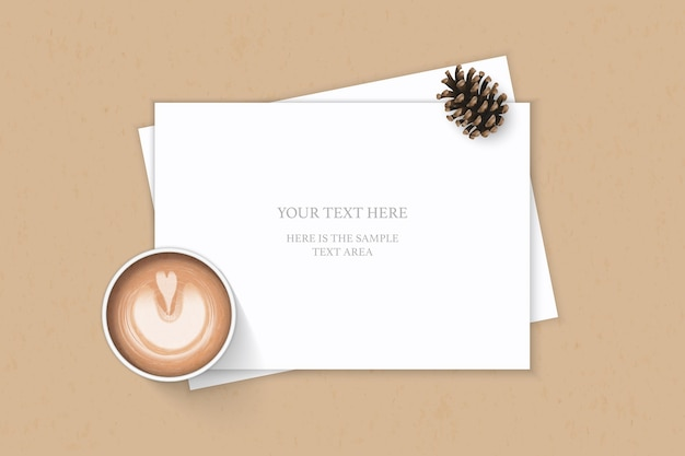 Flat lay top view elegant white composition paper pine cone and coffee on kraft background.