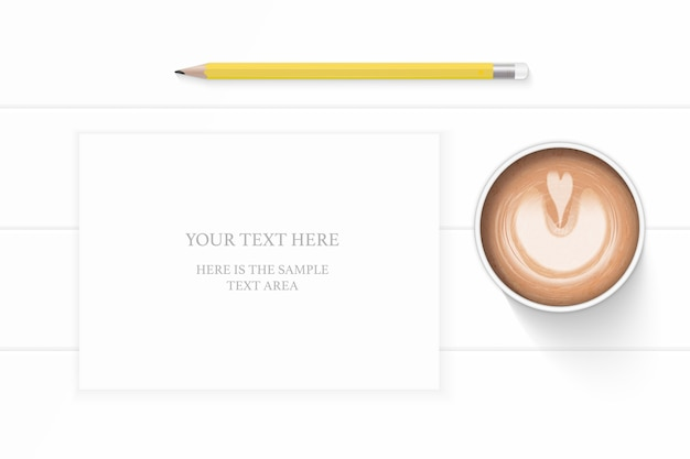 Flat lay top view elegant white composition paper yellow pencil and coffee on wooden background.