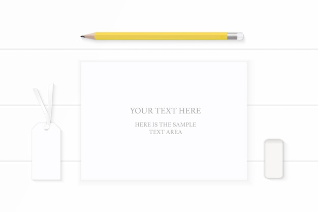 Flat lay top view elegant white composition paper yellow pencil eraser and tag on wooden background.