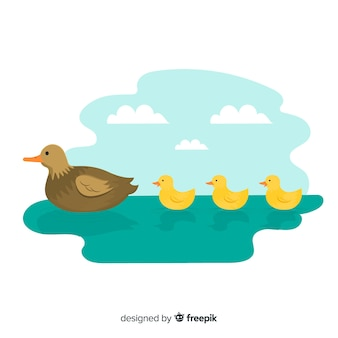 Flat mother duck and ducklings outdoors